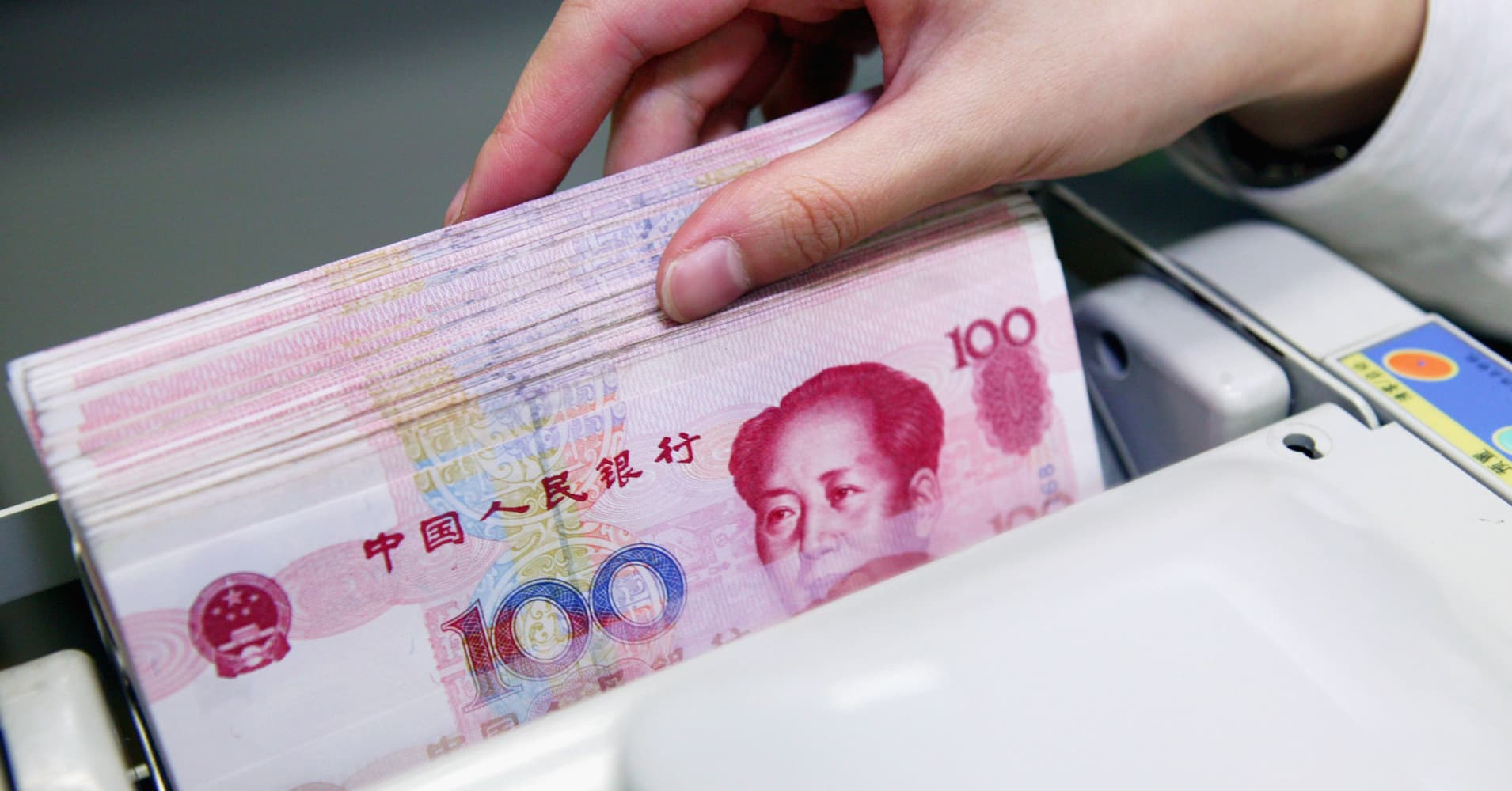 China's offshore yuan surges most against dollar in a year