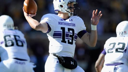 Trevor Siemian of the Northwestern Wildcats is about to pass in a game against the Minnesota Golden Gophers, October 11, 2014.