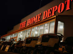 Riding lawnmowers stand in a row in the parking lot outside a Home Depot Inc. retail store in Bowling Green, Kentucky