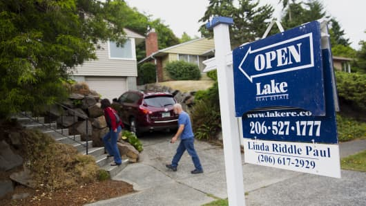 Potential homebuyers arrive to an open house in Seattle.