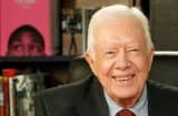Former US President Jimmy Carter poses for a photo as he promotes his new book 'A Call To Action Women, Religion, Violence, And Power' at Barnes & Noble, 5th Avenue on March 25, 2014 in New York City.