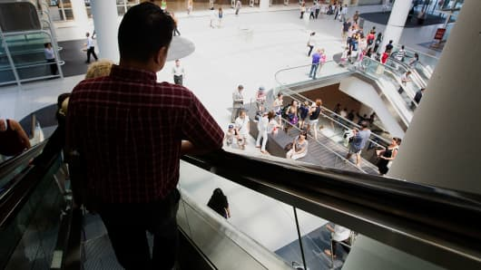 Canadian consumers shopping at the Eaton Center in Toronto, ON.