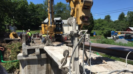 Workers work to repair a Pennsylvania bridge, northwest of Pittsburgh, under the state's Rapid Bridge Replacement Project.
