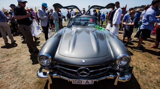Attendees look at a 1955 Daimler AG Mercedes-Benz 300 SL Gullwing during the 2015 Pebble Beach Concours d'Elegance in California, U.S.