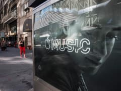 An advertisement for Apple Music is posted on the streets of Manhattan.