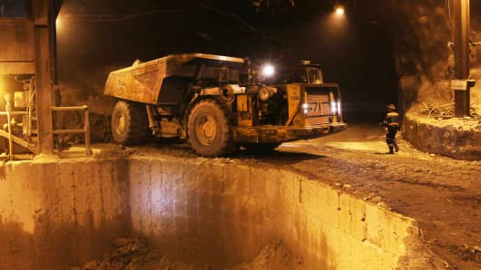 A dump truck prepares to unload ore into a crusher at Freeport McMoRan's Grasberg copper and gold mining complex in Papua province, Indonesia.