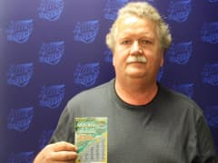 Danny Chasteen, of Oglesby, with a winning $250,000 lottery ticket in July. Chasteen said lottery officials told him that because lawmakers haven't passed a budget, the comptroller's office, which issues checks of more than $25,000, does not have legal aut