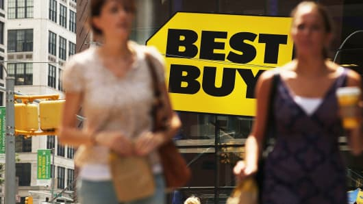 People walk by a Best Buy store in New York City.