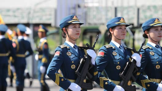Female soldiers of the Chinese People's Liberation Army attend a training session for the September 3 military parade.
