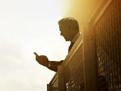Man with mobile phone in sun