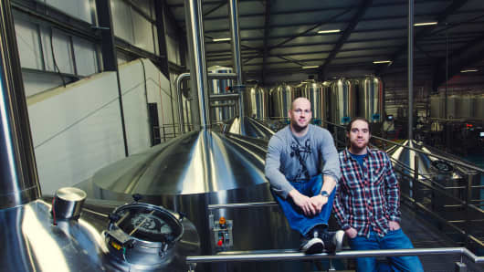 BrewDog founders James Watt, left, and Martin Dickie at their production facility in Ellon, Scotland.