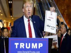 Trump signs GOP pledge... but is it binding?