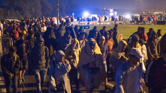 Migrants walking towards the border village of Nickelsdorf, Austria, in early hours on September 5.