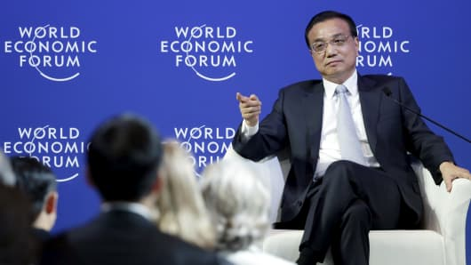 China's Premier Li Keqiang answers a question during a meeting with foreign company executives at the World Economic Forum (WEF) in China's port city Dalian, September 9, 2015. China must embrace its global obligations when it comes to combating climate change, Li said on Wednesday, adding that the country was already under huge pressure to meet emission reduction goals.