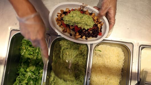 A file photo of a meal being prepared at a Chipotle restaurant.