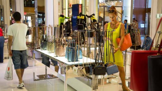 A shopper looks at a purse in a Macy's department store in New York.
