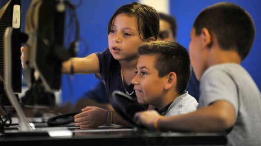 Children work on computers at a computer learning center in a Kingsley Commons apartment complex in Falls Church, VA.