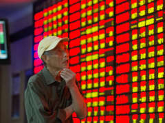 An investor observes stock market at a stoc