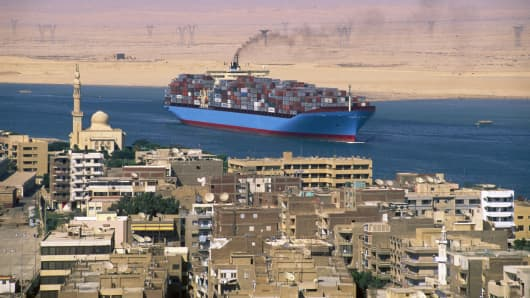 Container ship in Suez Canal, Egypt.