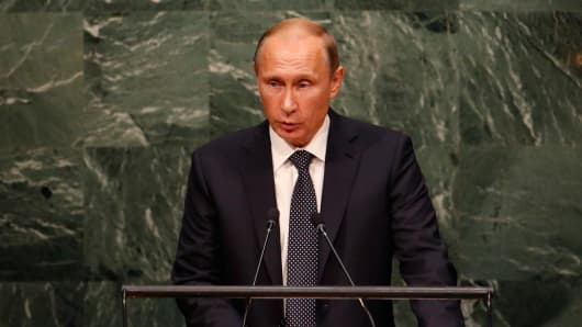 Russian President Vladimir Putin addresses attendees during the 70th session of the United Nations General Assembly at the U.N. Headquarters in New York, September 28, 2015.