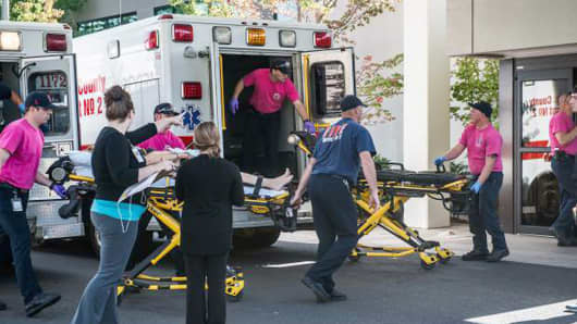 A patient is wheeled into the emergency room at Mercy Medical Center in Roseburg, Ore., following a deadly shooting at Umpqua Community College, in Roseburg, Thursday, Oct. 1, 2015.