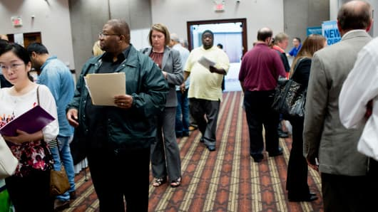 Job seekers attend a Job Fair Giant career fair in Sterling Heights, Michigan, Sept. 30, 2015