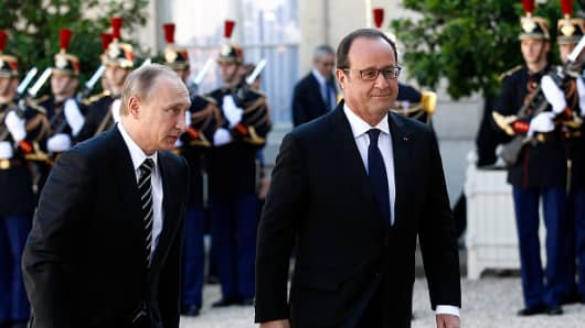 French President Francois Hollande welcomes Russian President, Vladimir Putin prior to their meeting at the Elysee Presidential Palace on October 02, 2015 in Paris.