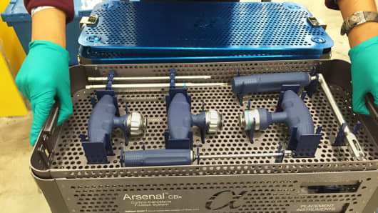 A medical device from Alphatec Spine is readied for shipment in a UPS facility.