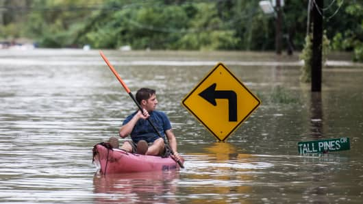 A man kayaks on Tall Pines Circle in Columbia, South Carolina, on Oct. 4, 2015.