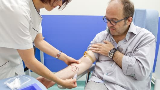 Clinical research in the GHICL. General neurology department at St Vincent de Paul hospital in Lille, France. A patient suffering from multiple sclerosis in its primary progressive form. The nurse carries out a blood test. (File photo).