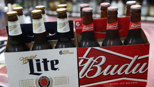 Bottles of SABMiller's Miller Lite and Anheuser-Busch InBev's Budweiser beer.