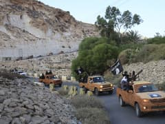 An armed motorcade belonging to members of Derna's Islamic Youth Council, consisting of former members of militias from the town of Derna, drive along a road in Derna, eastern Libya October 3, 2014. The group pledged allegiance to the Islamic State on Octo