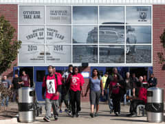 Fiat Chrysler Automobile (FCA) workers exit from the Warren Truck Assembly Plant at the end of their shift October 7, 2015 in Warren, Michigan.