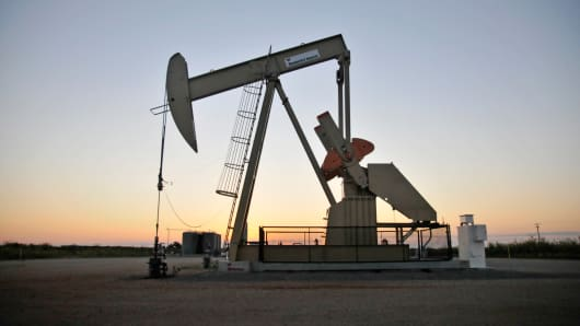 A pump jack operates at a well site leased by Devon Energy Production Co. near Guthrie, Oklahoma.