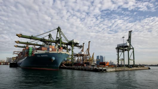 A container vessel docks at the Tanjong Pagar Terminal in Singapore.