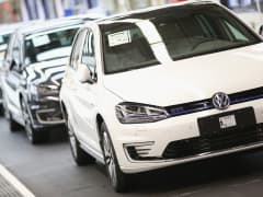 Finished Volkswagen cars arrive at the end of the assembly line prior to a visit by Volkswagen Group Chairman Matthias Mueller and Lower Saxony Governor Stephan Weil at the Volkswagen factory on October 21, 2015 in Wolfsburg, Germany.