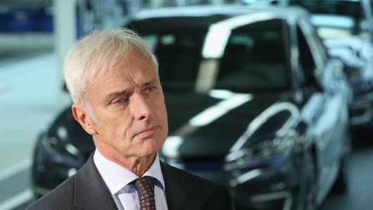 New Volkswagen Group Chairman Matthias Mueller speaks to the media with Volkswagen Work Council head Bernd Osterloh and Lower Saxony Governor Stephan Weil (both not pictured) while standing at the assembly line of the Volkswagen factory on October 21, 2015 in Wolfsburg, Germany.