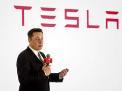 Elon Musk, chairman, CEO and product architect of Tesla Motors, addresses a press conference to declare the electric-car company will release its  v7.0 system in China on a limited basis for its Model S.