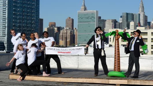 Actor's stage a tug-of-war between the rich and the poor to depict the world's struggle against inequality September 24, 2015 in New York.