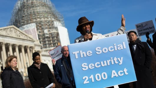 Maya Rockeymoore, president of the Center for Global Policy Solutions, speaks as House Democrats hold a news conference to announce the introduction of Social Security 2100 Act in front of the U.S. Capitol in April 2015.