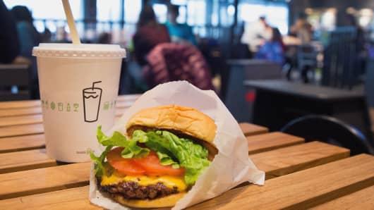 Shake Shack cheeseburger and drink.