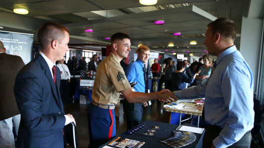 Job seekers meet with a Sacramento Police Department recruiter during the Hiring Our Heroes Job Fair at AT&T Park in San Francisco.