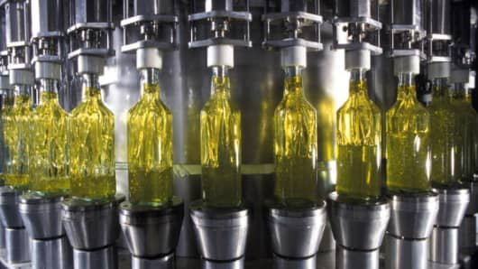 olive oil being bottled in the Carapelli Company's bottling workshop, in Florence, Italy.