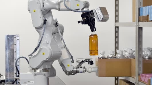 A prototype robot with two arms, demonstrates its abilities during a demonstration for the media at a warehouse in Noda, in suburban Tokyo.