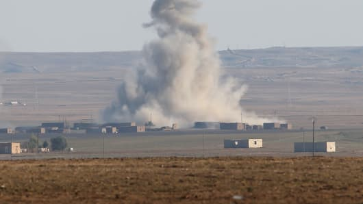 An airstrike by a U.S. led coaltion warplane explodes on an ISIL position on November 10, 2015 near the town of Hole, Rojava, Syria.