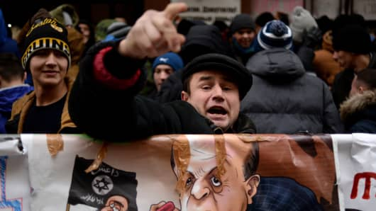 Several hundred young activists on Wednesday hurled stones and eggs as Turkey's embassy in Moscow and brandished anti-Turkish placards after Ankara downed a Russian warplane on the Syrian border.
