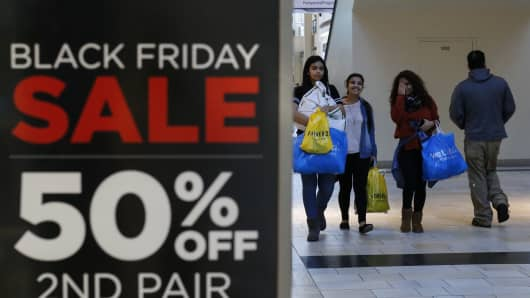 Customers carry shopping bags at the Newport Mall during Black Friday Sales on November 27, 2015 in Jersey City, New Jersey.