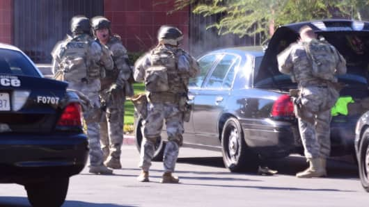 A swat team arrives at the scene of a shooting in San Bernardino, Calif. on Wednesday, Dec. 2, 2015. Police responded to reports of an active shooter at a social services facility.