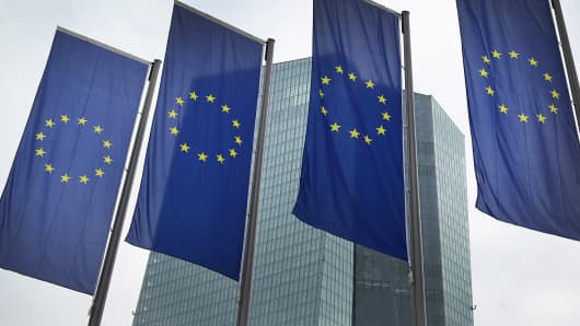 European Union flags in front of the headquarters of the European Central Bank in Frankfurt am Main, Germany.
