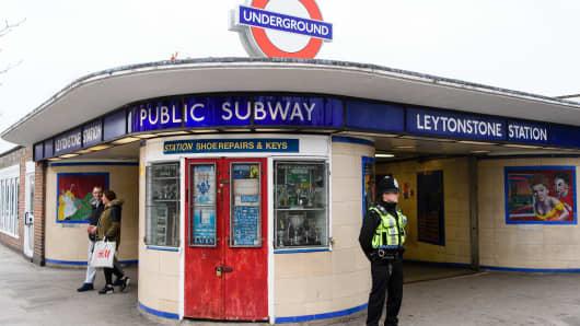 A police officer stands guard outside Leytonstone station, London on December 6, 2015.